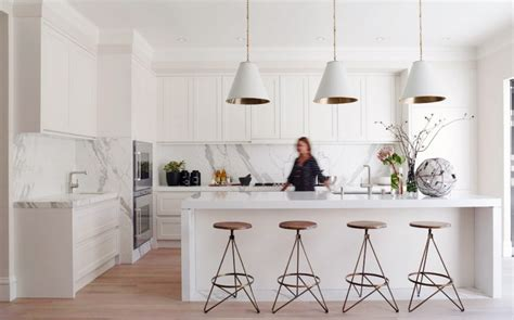 white marble kitchen island 30 modern white kitchens that exemplify refinement