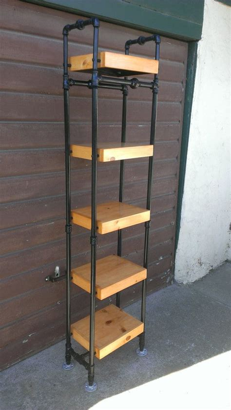 tower bookcase made with steel pipe frame and solid wood