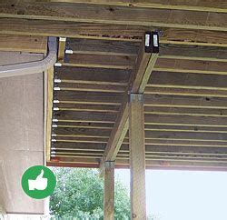 If sistering deck joists to floor joists isn?t an option