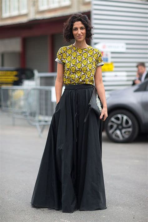 yellow crew neck t shirt and black maxi skirt and black