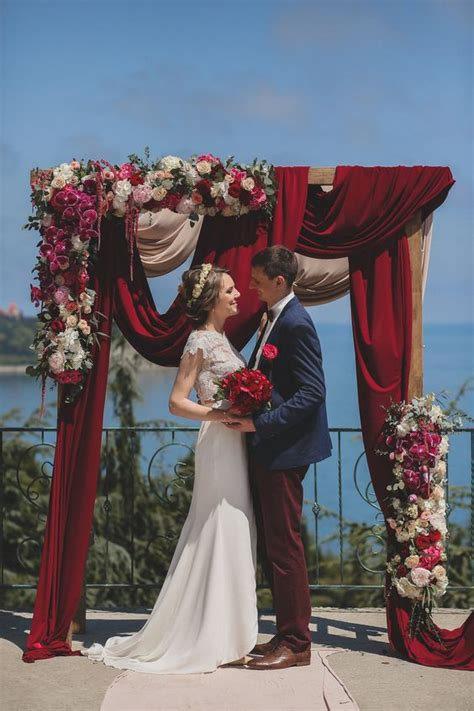 Home Decor A Sunset Design Guide Picture Of A Gorgeous Wedding Arch With Burgundy Draperies