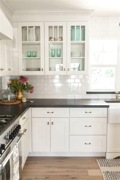 white kitchen cabinets black countertops  white subway