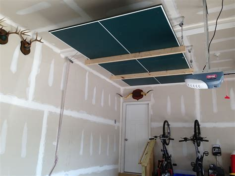 ping pong table in garage ping pong table on pulleys for more garage space my