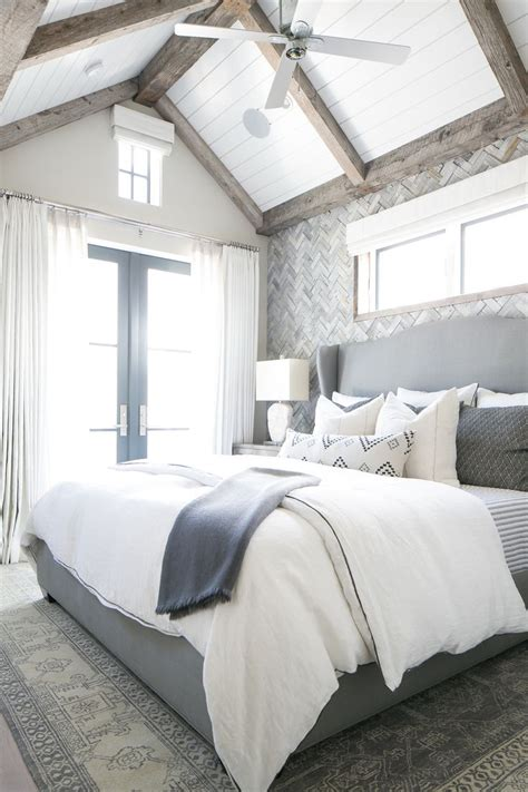 grey and navy bedroom the gray white and navy tones in this master bedroom are