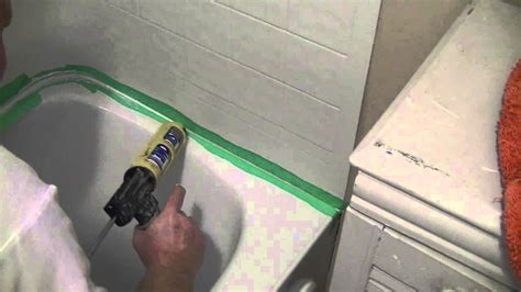what to use to seal bathtub how to silicone seal a tub surround to a tub youtube