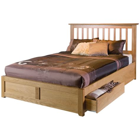 Brown Wooden Bed Frame With Carved Brown Stained Wooden Bed Frame With Curved Wooden Headboard On Ivory Fur Rug