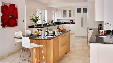 white shaker kitchen with oak island from harvey jones