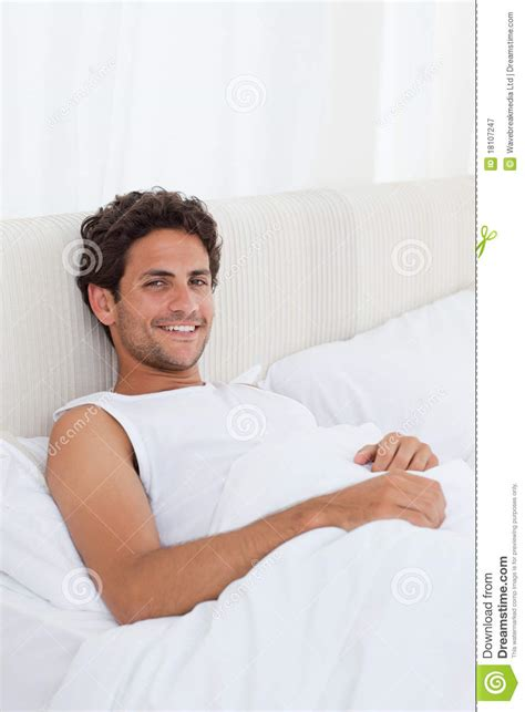 man in bed handsome man lying down in his bed royalty free stock