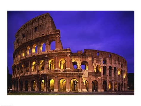 low angle view of a coliseum lit up at night, colosseum