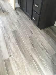 Bathroom Flooring Ideas Photos newly installed gray weathered wood plank tile flooring