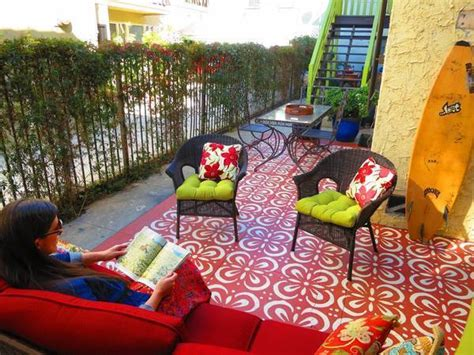 patio paint and stencil create carpet of color for outdoor