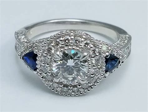 engagement ring with blue sapphire accents princess