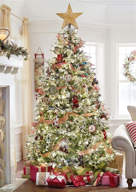 a snowy christmas tree decked out in american traditional