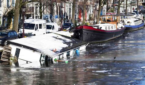 boat supplies amsterdam europe weather snow covers continent as temperatures