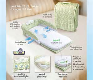 new baby delight snuggle nest green leaves