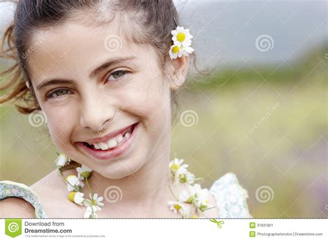 closeup of beautiful baby with flower headband stock photo closeup of happy in flower necklace stock