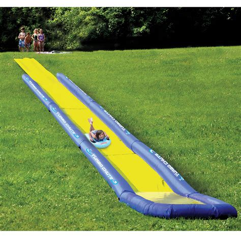 backyard waterslides the world s longest backyard water slide hammacher schlemmer