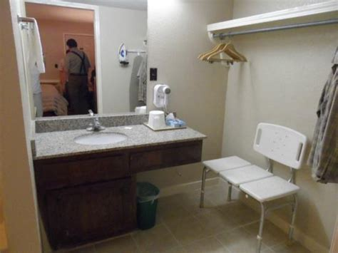 rm 103 lavatory clothes quot closet quot and tub shower chair