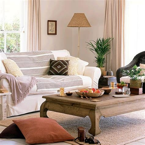 natural living room living room with natural tones and dark wood housetohome