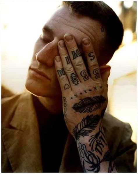 feather tattoo hand meaning feather tattoos for men ideas and designs for guys