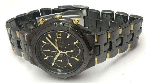 seiko mens chronograph water resist 100m two tone black
