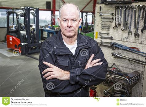 Forklift Technician by Mechanic In Forklift Garage Royalty Free Stock Images Image 38493809
