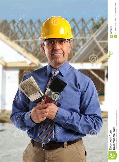 construction manager holding paintbrushes stock image image 34881451