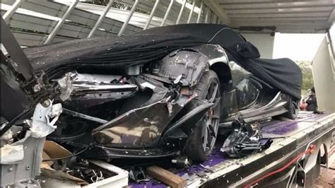 p1 crash mclaren p1 damaged in cambodia after truck carrier crashes
