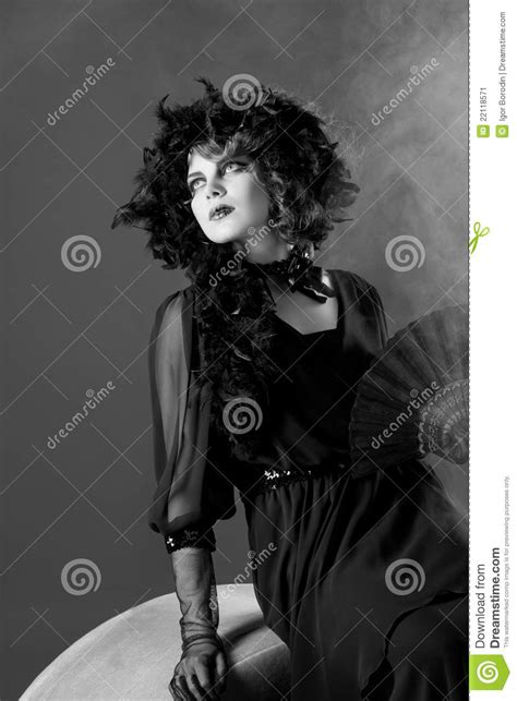 woman in old fashioned dress in black white stock image