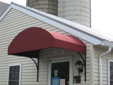 awning and canopy arched canvas commercial awning installed over a door