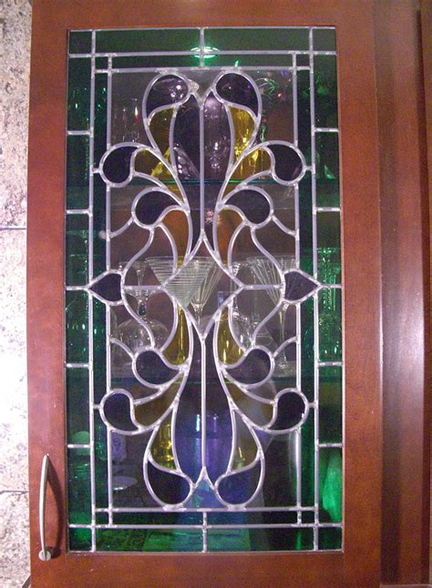 custom designed stained leaded cabinet glass and etched