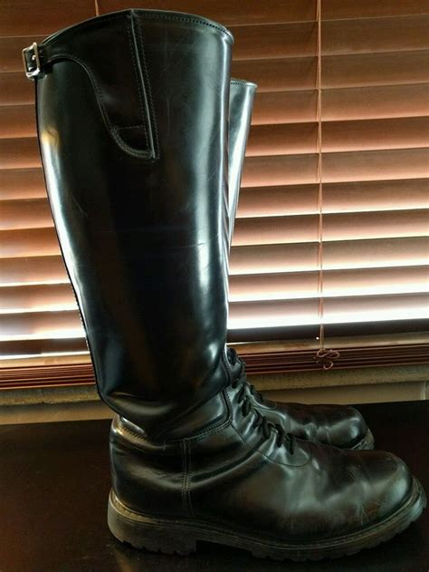 tall motorcycle boots tall leather well worn used police patrol motorcycle boots
