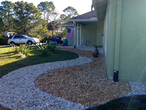 landscaping around house foundation low maintenance rock landscaping in melbourne and vero beach construction landscape