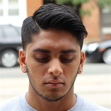 regular haircut for men men s regular cut with tapered sides and side part on dark
