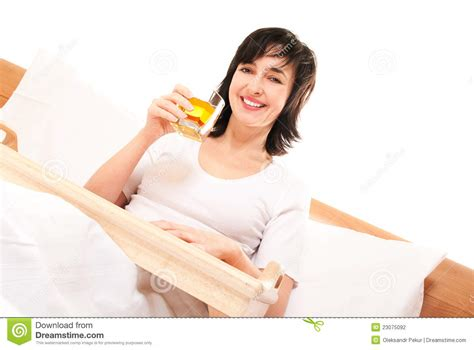 how to make a woman happy in bed happy woman in bed with apple juice stock photography