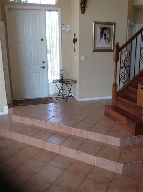 different entryway flooring then flooring through rest of