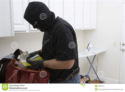 house stealing burglar stealing money from house stock photos image 29659743