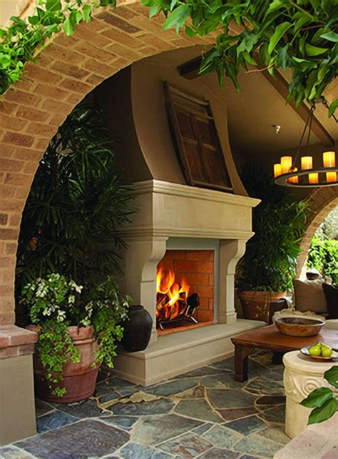 arched entry into covered patio love the fireplace