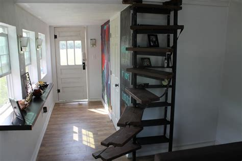 kaitlin snyder s custom spiral staircase and bookshelf is