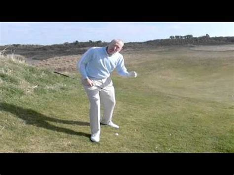 golf swing tips youtube golf swing tips chipping off a downhill lie youtube