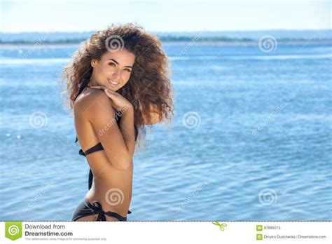 ambre suit curly hair young attractive smiling slender girl with curly hair in
