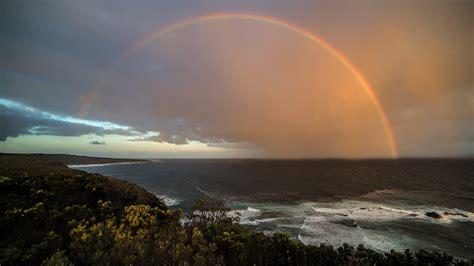 photo rainbow coast sunset beach sky