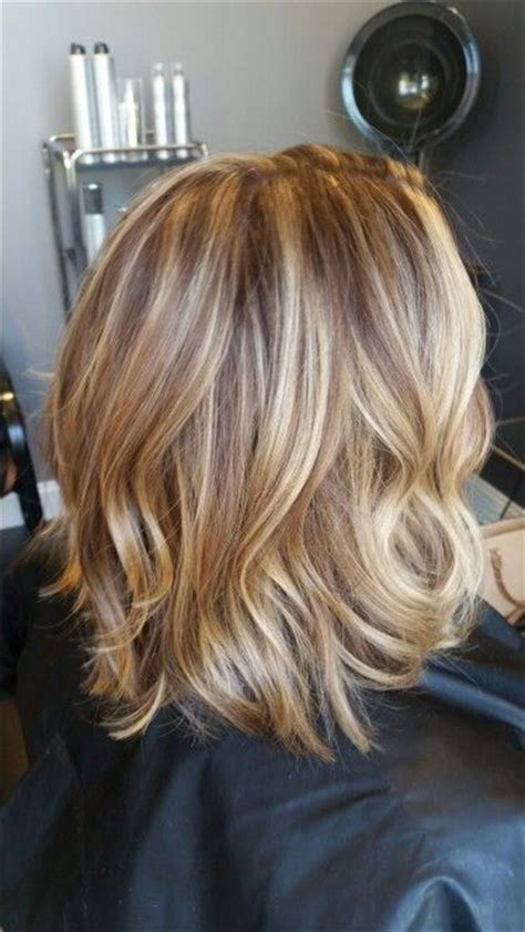 layered hair with low lights highlights short blonde lob with highlights and lowlights by brianna thomas
