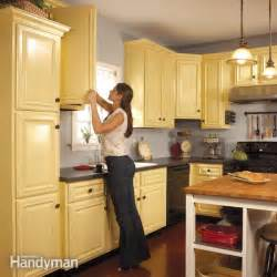 Repaint Kitchen Cabinet How To Spray Paint Kitchen Cabinets The Family Handyman