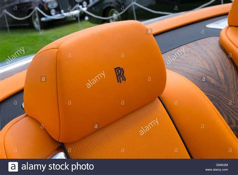 roll royce orange orange headrests on a rolls royce wraith with the rr