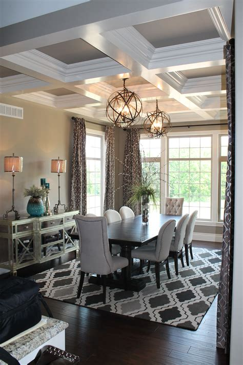 Chandelier Above Dining Table Two Globe Chandeliers Hang Above The Dining Room Table Design And Furnishing By Design Source