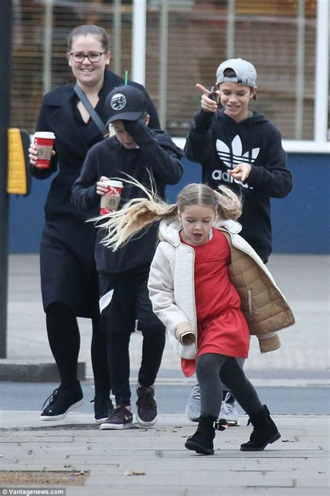 romeo beckham school london wetherby harper beckham looks sweet in festive red dress as she