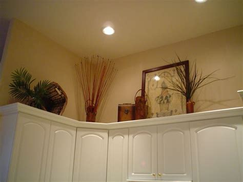 decorating above kitchen cabinets with vaulted ceiling decrating ideas decorating ideas for above kitchen