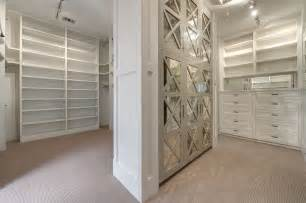 Closet Flooring by Walk In Closet With Mirrored Cabinets Transitional Closet