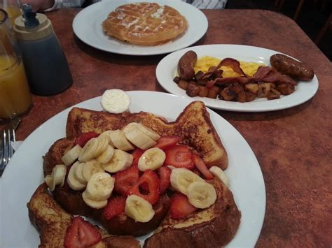 maywood pancake house challah french toast with strawberries and banana daddy o combo eggs sausage bacon